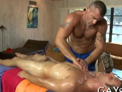 Slippery gay studs fuck during a steamy massage