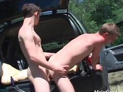 Gorgeous horny twink gets boned in a car trunk