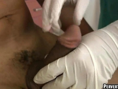 Horny hunk getting his hard cock tugged by his doctor